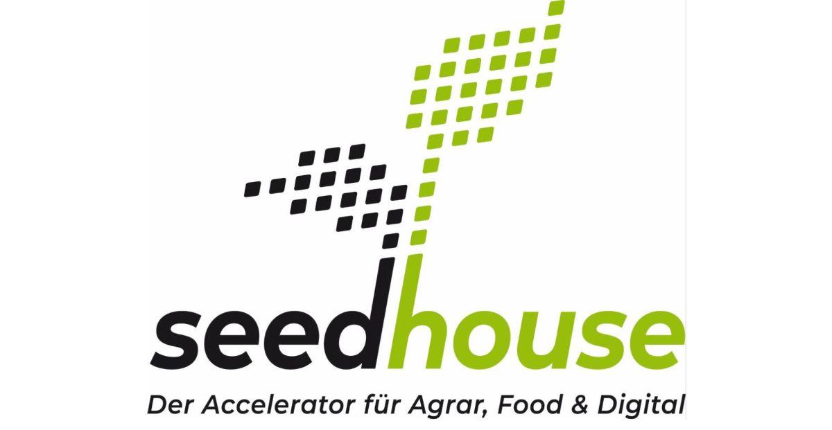 Logo des Seedhouse in Grün und Schwarz mit stilisiertem Pflanzensetzling.